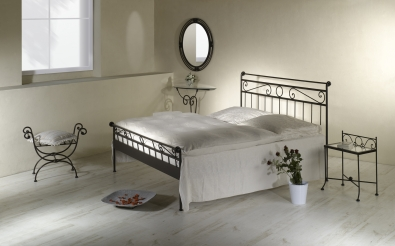 Bedroom in romantic style with hand wrought bed