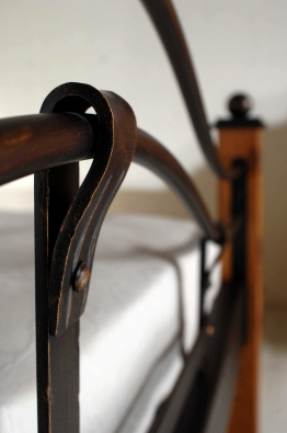 forged bed wood and metal